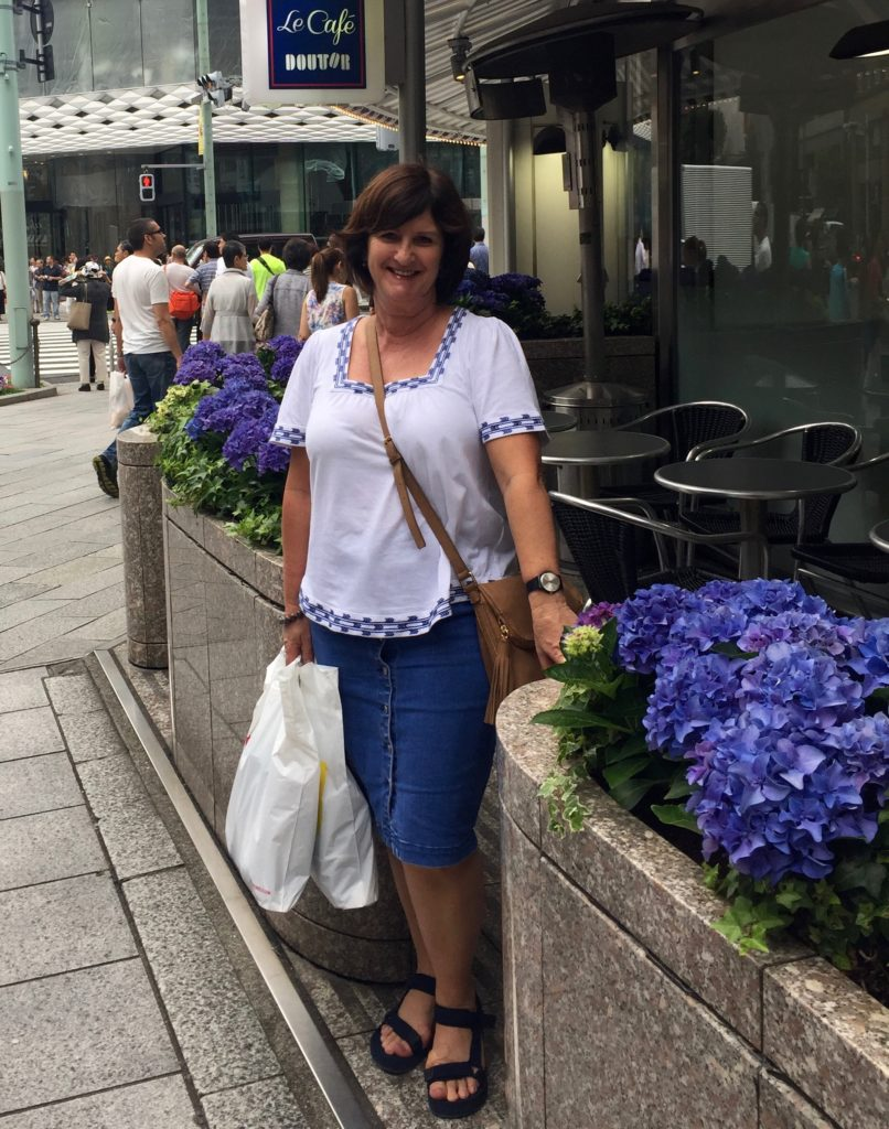 A knee length denim skirt looks good teamed with loose fitting top is a good casual look