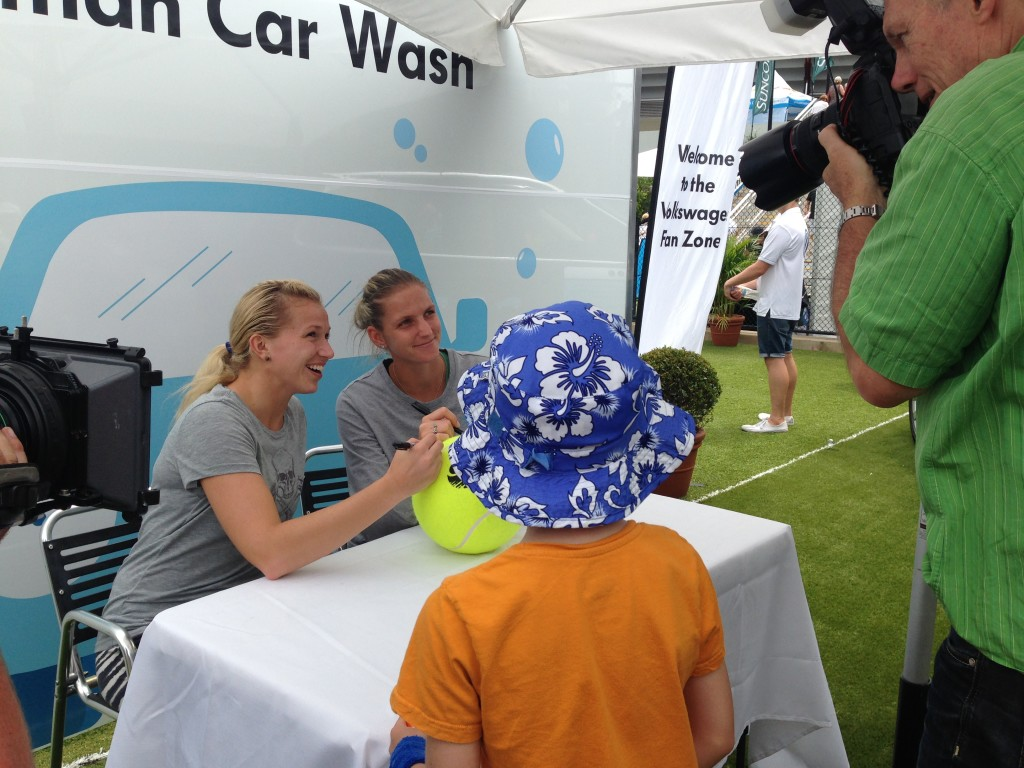Some of the tennis stars signing autographs