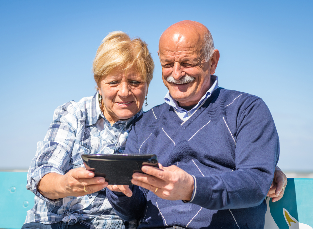 seniors looking at ipad