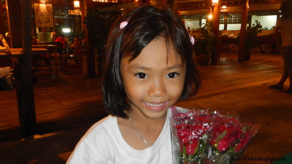 Little girl in Phuket selling roses