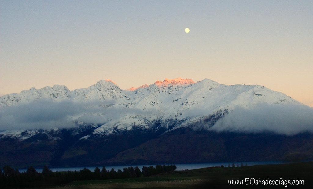 The sun shedding a little light on the Mountains surrounding Lake Wakatipu